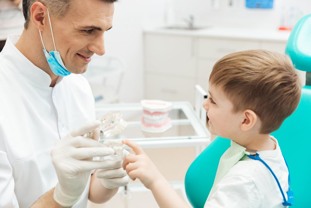 Boy on consultation of pediatrician dentist